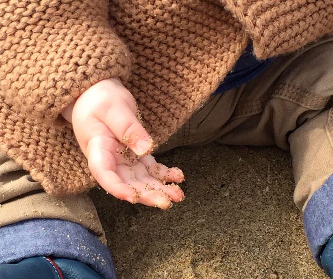 sandy baby hands