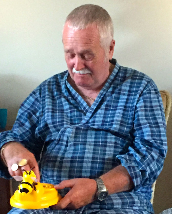 Grandad playing beehive surprise