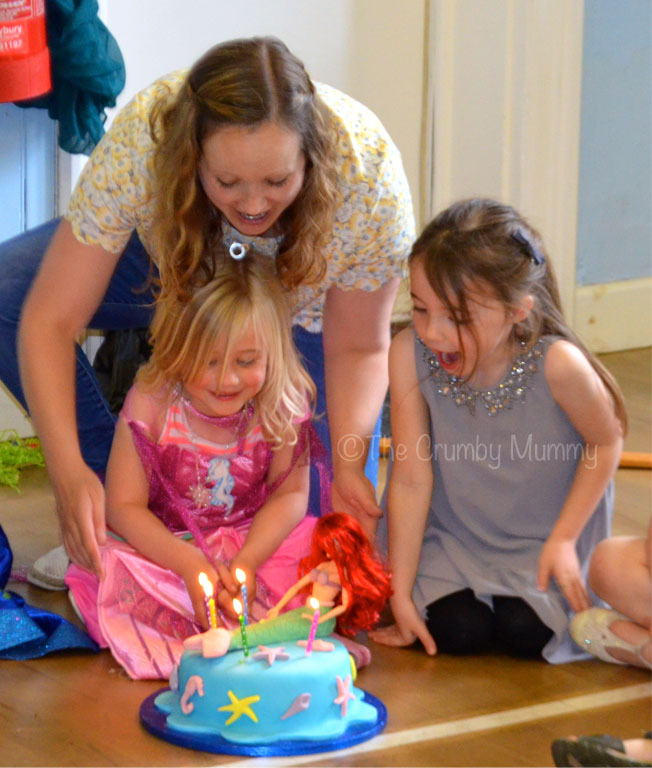 singing happy birthday with candles