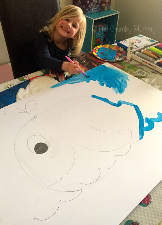 painting a pin the tail on the whale under the sea party game