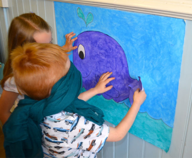 playing pin the tail on the whale an under the sea party idea