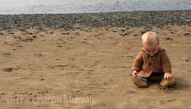 baby's first time on the beach