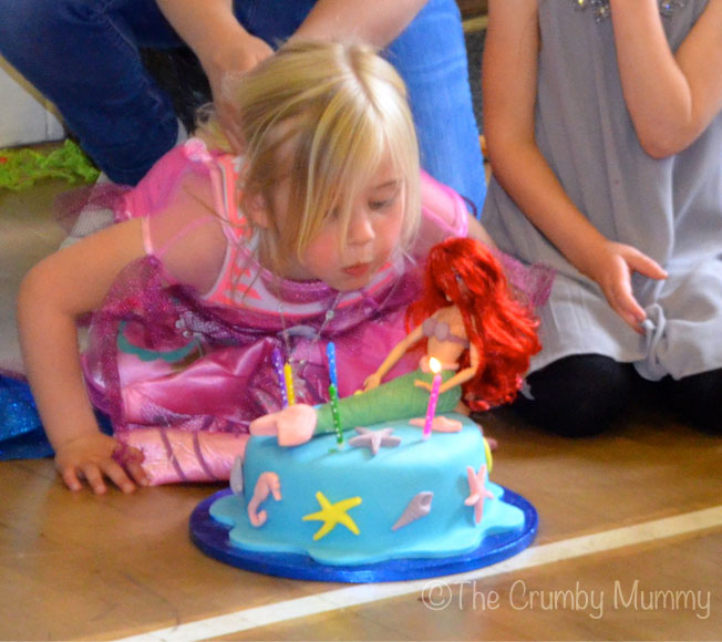 my little mermaid blowing out her candles